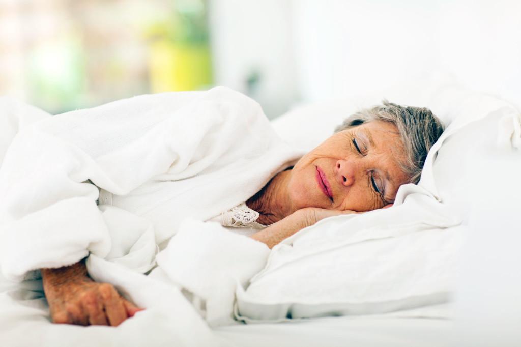 senior-woman-sleeping-bed